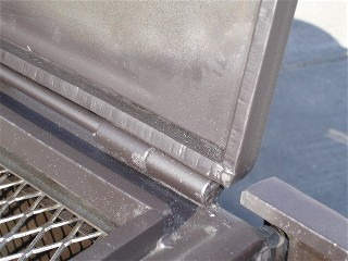 corner photo of a 1/2 hinch firebox from a portable bbq smoker