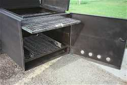 BBQ GRILLS SHOWING ON THE BBQ SMOKER FIREBOX